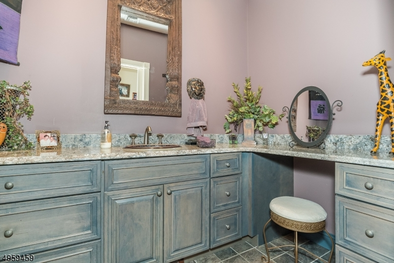 Full Bathroom full of light and rustic appeal offers plenty of storage space for bathroom essentials.