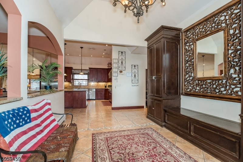 What a welcoming sight upon first coming inside! Sprawling entryway warmly welcomes you in. Both spacious and functional, there is plenty of space to sit when putting on or taking off shoes, as well as storage room for all your front-entry necessities.