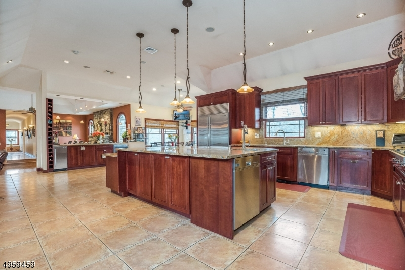 Large open Gourmet Kitchen packed with amazing features is ideal for everything from food prep to casual dining and entertaining.