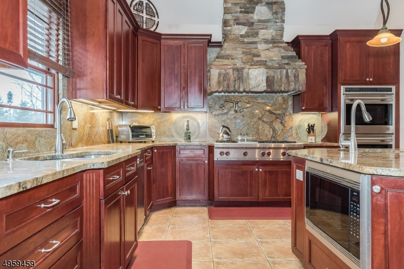 High quality cabinetry, top of the line stainless steel appliances and an attractive stone range hood add the perfect touch of elegance.
