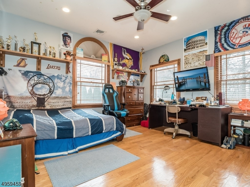 Spacious Bedroom with plenty of room for larger furniture, provides plenty of natural light and scenic views from the large windows.