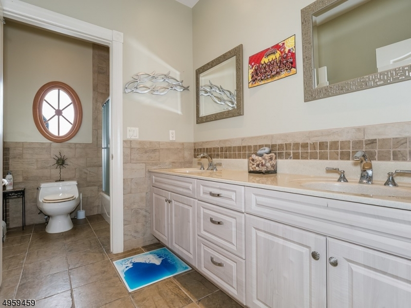 Tastefully decorated full Bathroom features dual vanity with matching mirrors that's separate from shower and toilet! Very convenient for more than one person to prepare for their day!