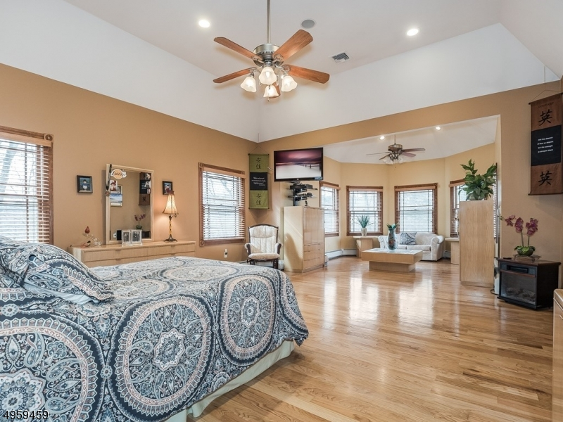 Master Bedroom Suite is the perfect place to relax after a long day. Gleaming hwd flrs, recessed lighting, 2 walk-in closets & plenty of space for dressing, sleeping and relaxing! Private sitting area, highlighted by plenty of windows & natural light.