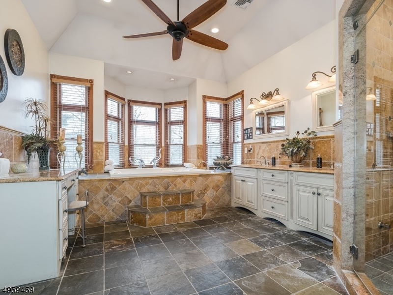 Gorgeous Master Bathroom with luxury fixtures, relaxing jacuzzi, dual sinks and separate vanity, delivers blissful-comfort and flawless functionality.