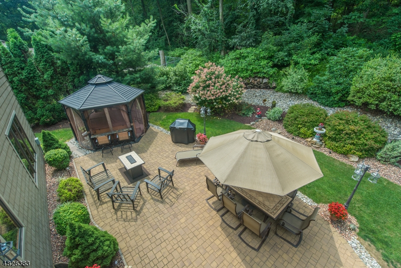 Paver patio, gazebo with hot tub,,,,backs up to wooded privacy