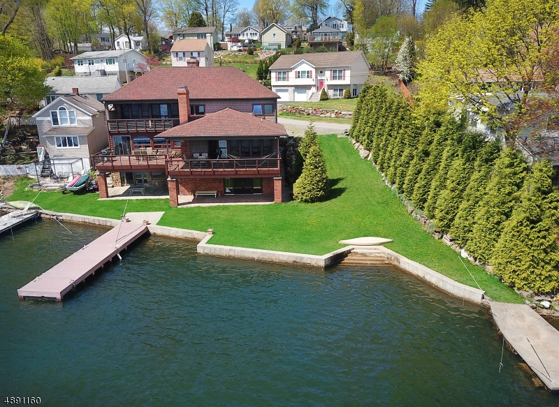 Gorgeous 3 Level Lakefront Home with multiple decks, 2 Docks and plenty of Frontage for Multiple boats and Jet skis