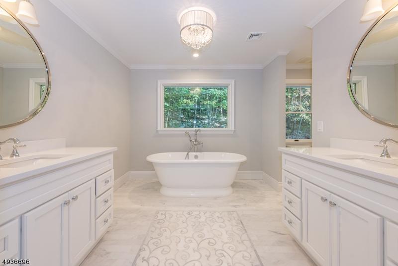 Luxurious Master Bath with decorator marble floor, custom vanity w/dual sinks, quartz tops, soaking tub & stall shower