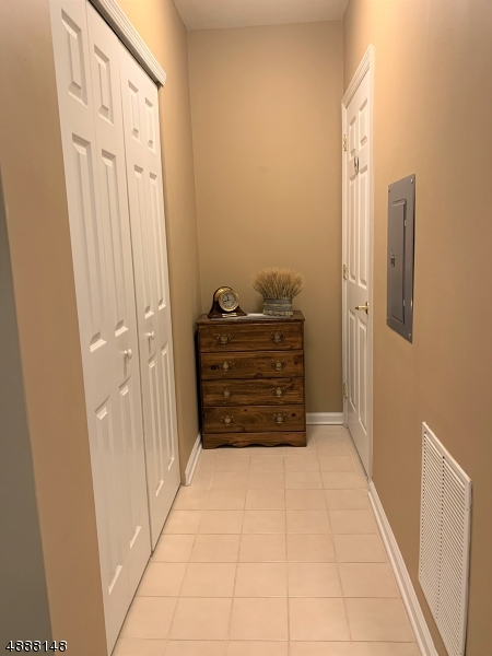 Hallway off the entryway/kitchen area, offering a double closet for your storage and a private entry into the bathroom for you and or your guests.