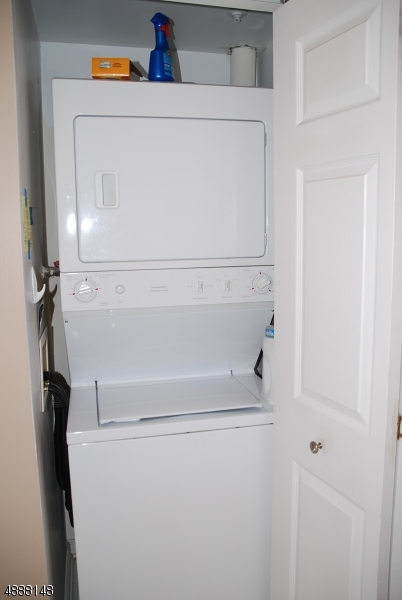 Located in the bathroom, the washer/dryer stackables are housed in a closet.
