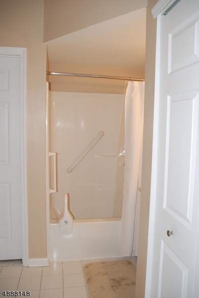 Beautiful and bright bathroom with neutral decor.  Clean as a whistle.  Laundry closet with stackable washer and dryer.