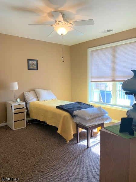 Bright and sunny bedroom with walk in closet and main bath access.