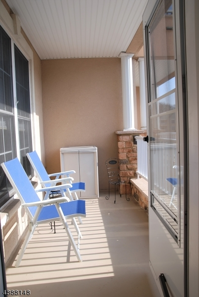 Enjoy a breath of fresh air just off your living room with this lovely and sunny balcony.