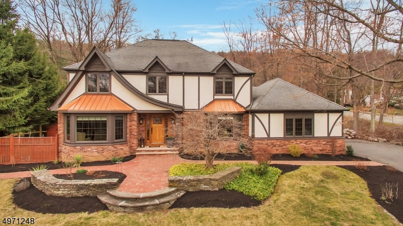 Custom remodel of the home in 08' included new front elevation adding brick,bay windows,sandstone open front porch&rich wood front door w/side panels &brick walkway.Extensive landscaping w/stone walls & garden beds +underground sprinklers in front yard.