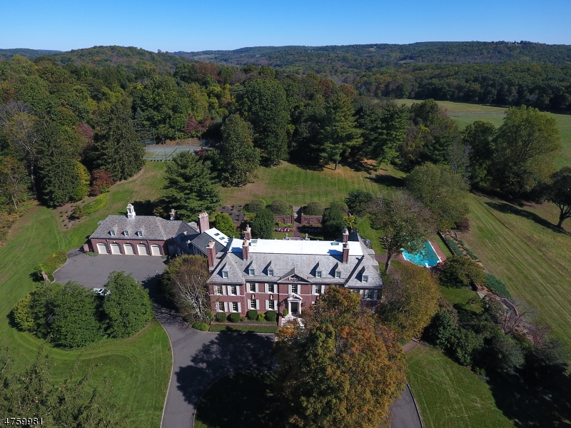 One of Peapack-Gladstone's grand estates, perched atop 62+  acres, overlooking the Somerset Hills with breathtaking, unobstructed views of the rolling countryside.