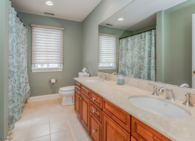The main bath is on the 2nd floor with double sinks and a full bath.