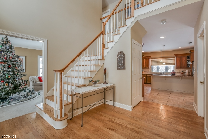 As you step in the foyer with its cathedral ceiling, you'll find an office or den to the right. On the left side is the formal living room.