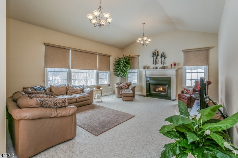 Relax in your family room with the convenience of a gas fireplace to make the room cozy. Many windows to let in the natural sunlight.