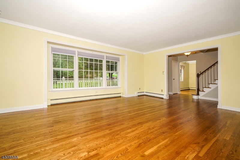The large living room boasts hardwood floors and delightful picture window right off the foyer.