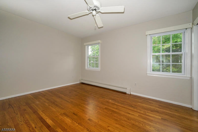 There are two other second floor bedrooms with hardwood floors, double closets and lighted ceiling fans.