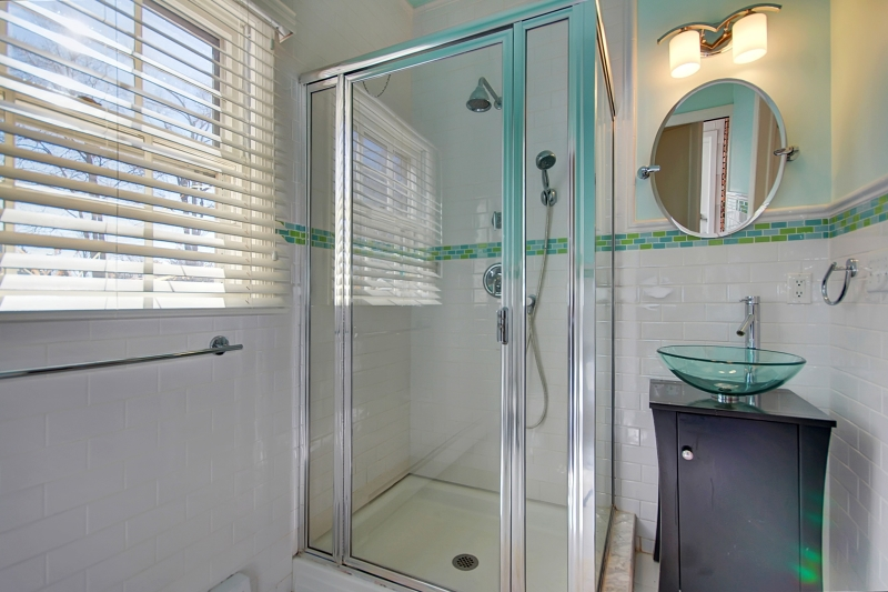 Full Bath with stall shower and decorative sink with vanity