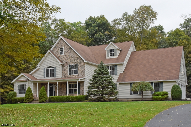 Beautiful custom colonial nestled on just over 2 acres