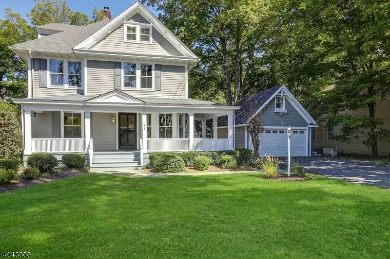 Charming Colonial/Victorian on beautifully landscaped property