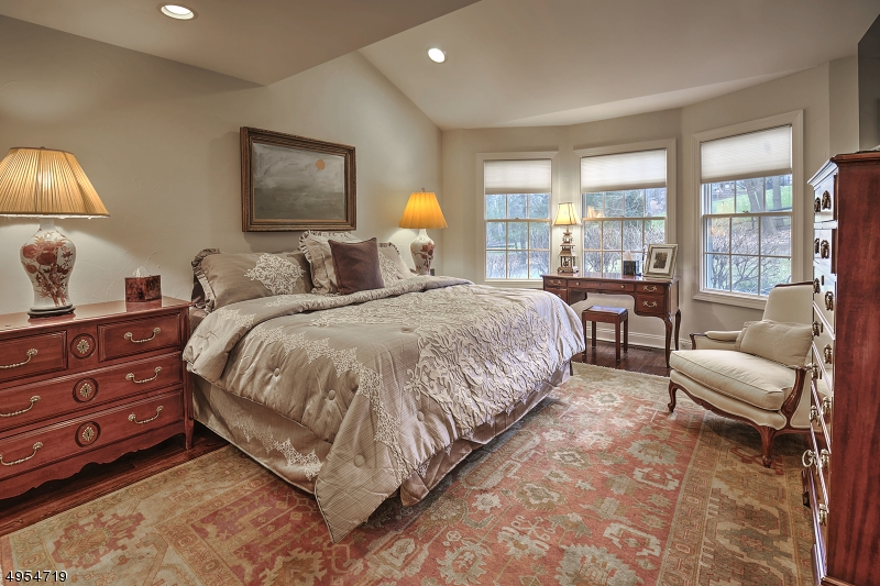 Meticulously appointed, hardwood floors, natural light from large windows