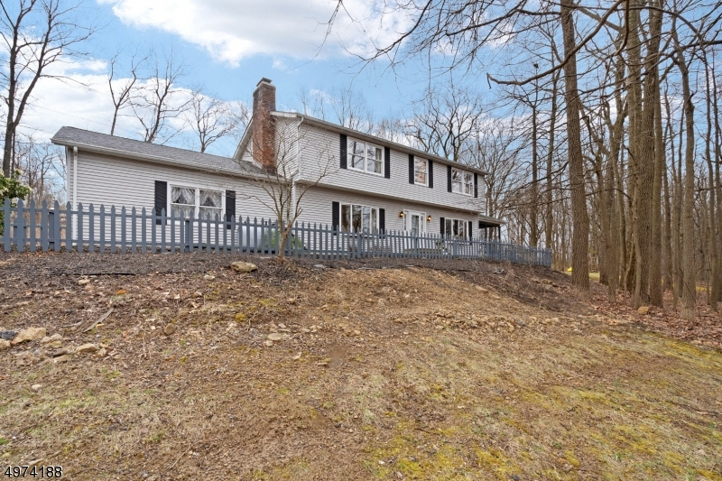 Beautiful 4 bedroom colonial on corner lot on cul-de-sac street - 2.36 acres provides privacy in a quiet neighborhood