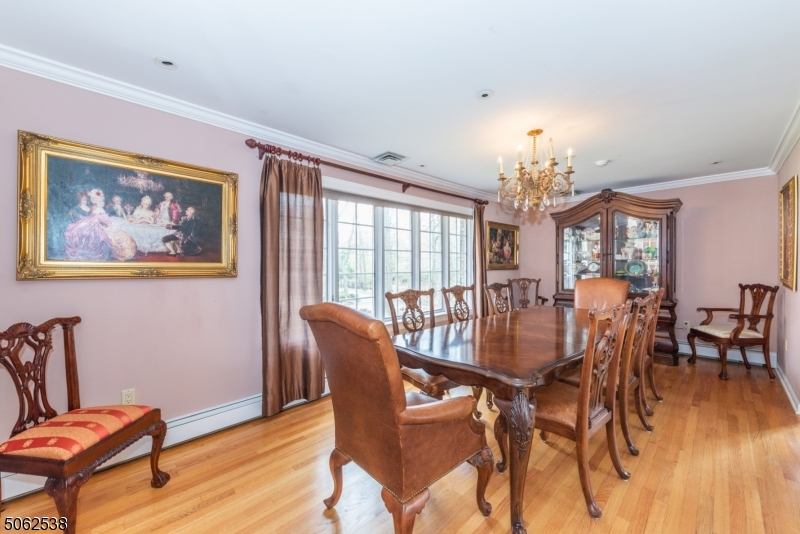 Large dining room with spotless hardwood floors