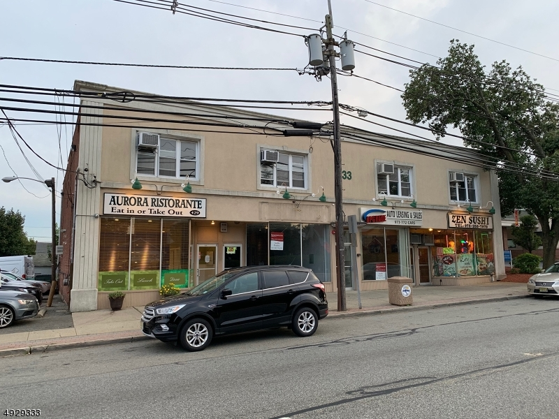 Photo of home for sale at 433 Piaget Ave. - Store 2, Clifton City NJ
