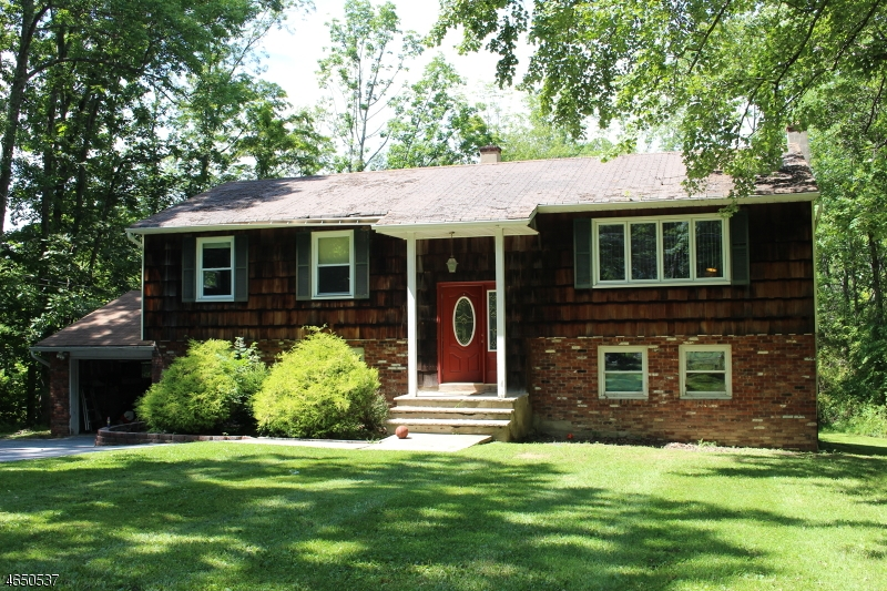 Photo of home for sale at 60 Possaghi Rd, Hampton Twp. NJ