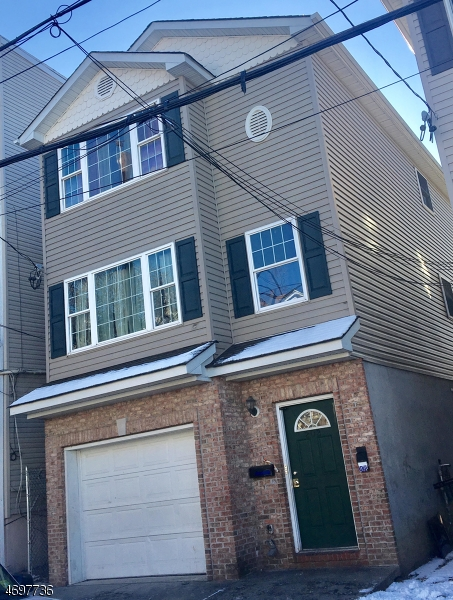 Photo of home for sale at 200 Harrison St, Paterson City NJ
