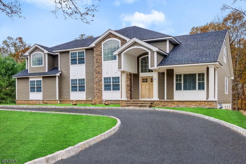 Photo of home for sale at 24 Blackstone Drive, Livingston Twp. NJ