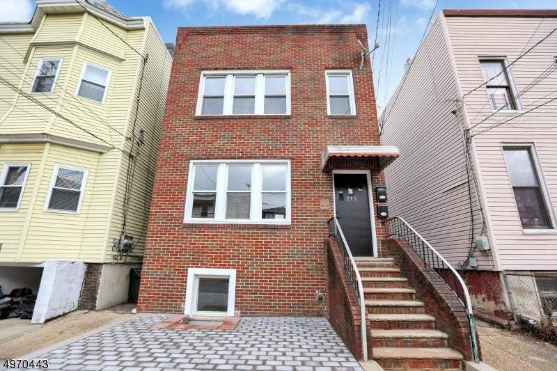 Photo of home for sale at 212 HUTTON ST, Jersey City NJ