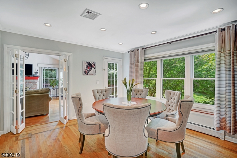 Dining room perfect for entertaining with glass bi-fold doors to cathedral family room.