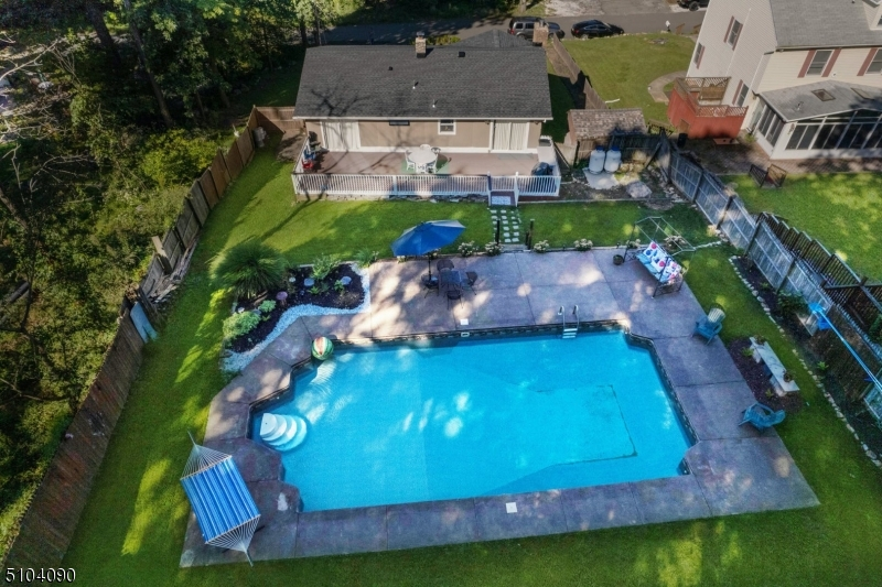 Lovely home with many 2021 improvements, inground pool & lush landscaping