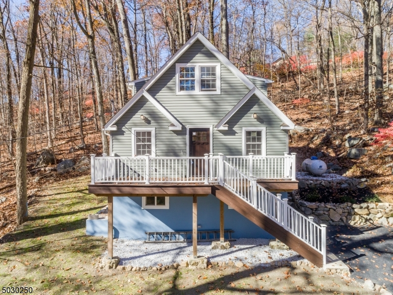 Nestled in the trees come see this charming chalet.