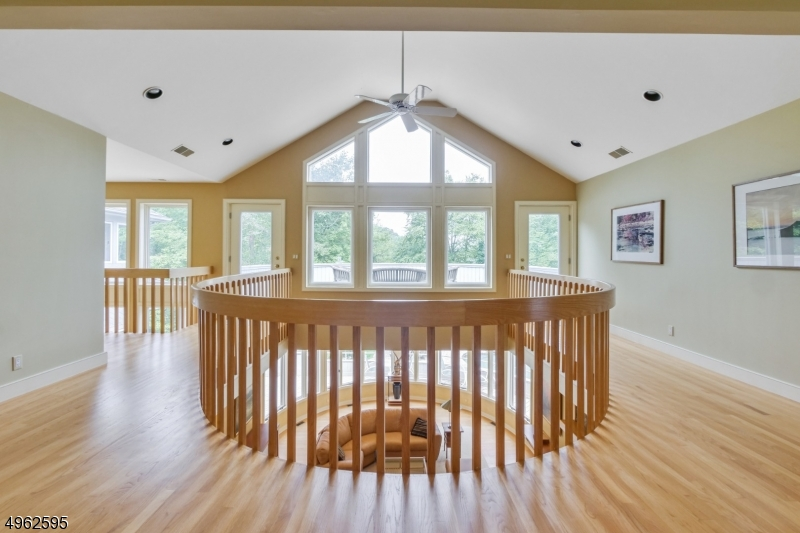 Incredible lake views from the second floor landing and exterior  deck.
